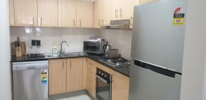 A kitchen or kitchenette at Liv Arena Apartments Darling Harbour