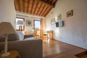 Area soggiorno di Amalia Apartment - Mercato Centrale