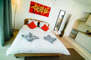 A bed or beds in a room at Corvin Apartment Budapest