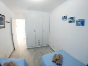 A bed or beds in a room at Beautiful Apartment-Bungalow Puerto Rico Mogan Gran Canaria