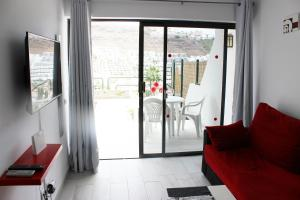 A seating area at Beautiful Apartment-Bungalow Puerto Rico Mogan Gran Canaria