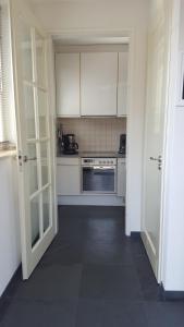 Een keuken of kitchenette bij Augustinushof 13