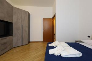A bed or beds in a room at Brera Design District Luxury Apartment