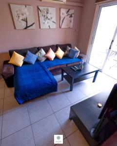 A seating area at Tasos Apartment
