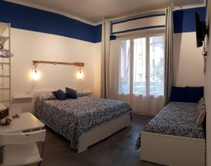 A bed or beds in a room at Il Sogno apartaments