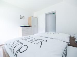 Postelja oz. postelje v sobi nastanitve Apartments and rooms Nataša 2