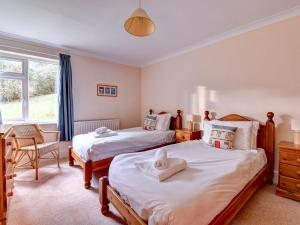 A bed or beds in a room at Spedding Fold