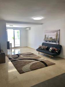 A bed or beds in a room at Apartment Puerto Paraiso Estepona Seaview for 5 People