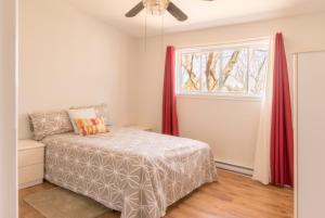 Een bed of bedden in een kamer bij paradissurterre