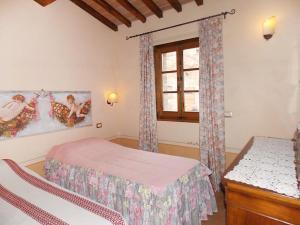 Letto o letti in una camera di Locazione turistica Valiano