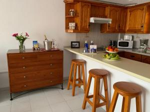 A kitchen or kitchenette at Apartamento Sol