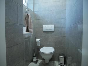 A bathroom at D18 Airport Apartments