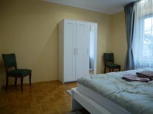 A bed or beds in a room at D18 Airport Apartments