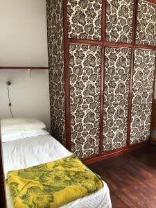 Letto o letti in una camera di Delizioso appartamento in residence