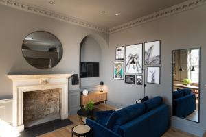 A seating area at Hiding Space - Trim Street Apartments