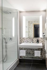 Ванная комната в Aparthotel Adagio La Défense Esplanade
