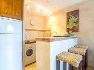 A kitchen or kitchenette at Apartment Les Carles
