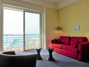 Ein Sitzbereich in der Unterkunft Apartment La Pergola.2