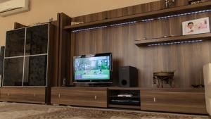 Телевизор и/или развлекательный центр в McDonalds Home&Terrace