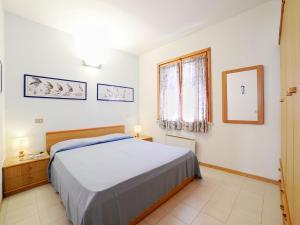 A bed or beds in a room at Locazione turistica Salita Bellavista