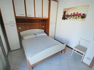 Postel nebo postele na pokoji v ubytování Locazione turistica Green