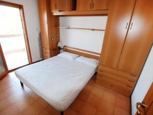 Postel nebo postele na pokoji v ubytování Locazione turistica Lecci.1
