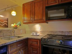 A kitchen or kitchenette at Apartment Coconut Grove.1