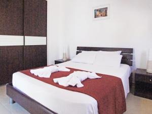 Ein Bett oder Betten in einem Zimmer der Unterkunft Villa KPPOS18