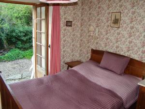 Un ou plusieurs lits dans un hébergement de l'établissement Holiday Home Shangri-la
