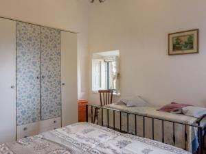 Letto o letti in una camera di Locazione turistica Biscotti's.1