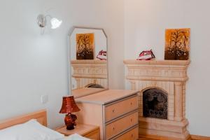 Кровать или кровати в номере Central Flower Apartment