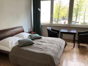 Ein Bett oder Betten in einem Zimmer der Unterkunft STARS Apartments Berlin Schöneberg