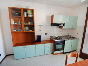Kuchyň nebo kuchyňský kout v ubytování Locazione turistica Hermitage.2