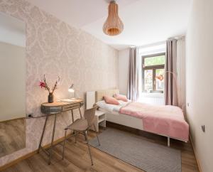 Ein Bett oder Betten in einem Zimmer der Unterkunft Royal Vega Apartment