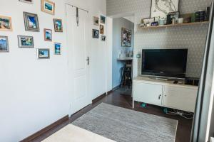A television and/or entertainment center at HostnFly apartments - Superb apartment 2 steps from the Stade de France