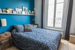 A bed or beds in a room at HostnFly apartments - Superb apartment 2 steps from the Stade de France