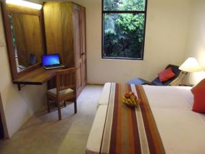 A bed or beds in a room at Natures Treat Bungalow