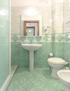 Ein Badezimmer in der Unterkunft Renda Apartments