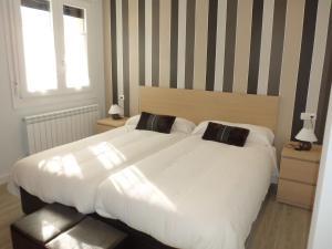A bed or beds in a room at CASA SAN NICOLAS