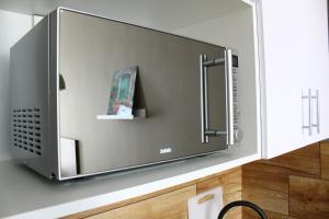 Телевизор и/или развлекательный центр в Business apartment complex