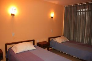 A bed or beds in a room at Departamentos Tambo