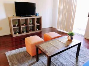 A television and/or entertainment center at 6 mins to Strip ENTIRE condo w/ FREE Parking WiFi