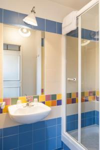 A bathroom at Aparthotel Adagio Marne La Vallée - Val d'Europe