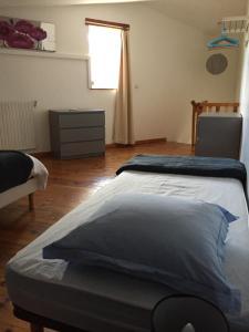 Un ou plusieurs lits dans un hébergement de l'établissement Melyne Location