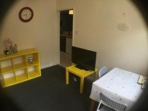 A television and/or entertainment center at Entire Cozy Flat With Big Garden