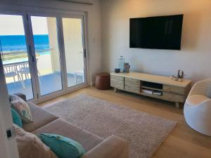 A seating area at Cottesloe Beachfront Ocean View Apartment