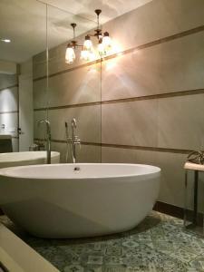 A bathroom at LUXURY GOA SKYVILLA at TREAS opp HILTON GOA RESORT with a Private Plunge Pool