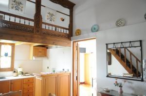 A kitchen or kitchenette at Pegasus Studios & Apartments