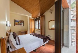 Cama o camas de una habitación en Apartaments Sant Moritz