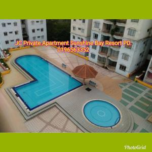A view of the pool at JC Apartment Sunshine Bay Resort Port Dickson or nearby